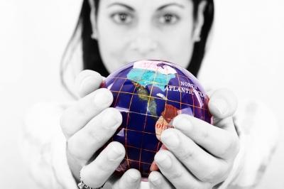 woman holding globe