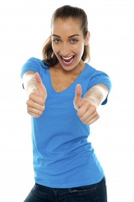 Overjoyed Woman Showing Double Thumbs Up