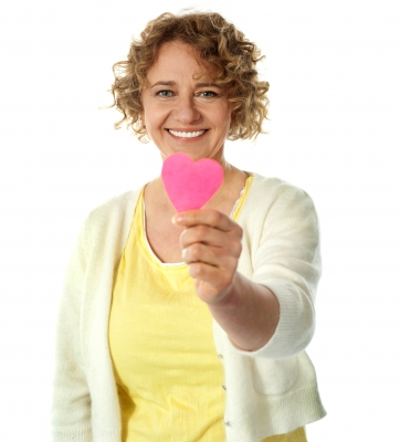 smiling lady sharing her paper heart