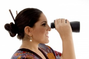 woman looking in binoculars