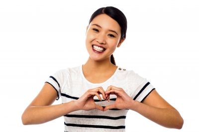 """Pretty Woman Making Heart Symbol With Hands"""