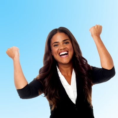 """""""Excited Businesswoman With Clenched Fists"""""""
