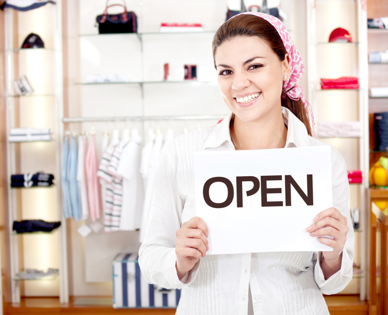 female entrepreneur with open sign