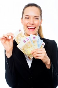 smiling woman holding money