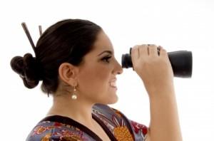 woman looking in binoculars